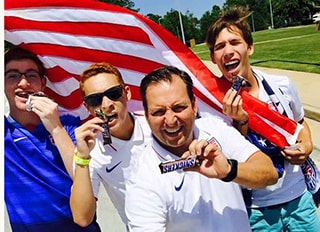 Dr. Griffin with a group holding an American Flag
