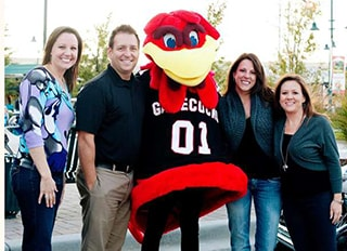 Dr. Griffin and his staff next to a Turkey Mascot.