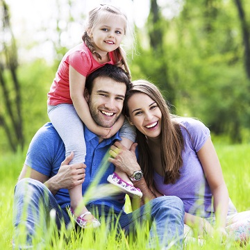 A happy young family to illustrate general dentistry dental services in Columbia, SC can help your family keep their smiles healthy and happy for a lifetime!