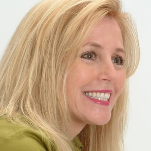 A woman smiles to show how dental implants from this dentist in Columbia, SC can restore your smile.