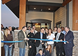 Dr. Griffin at a ribbon cutting.