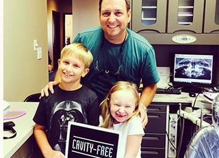 Dr. Griffin with two young patients
