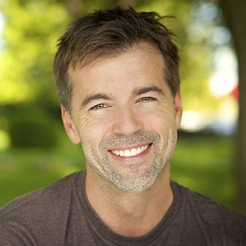 Handsome, smiling, mature man to illustrate the restorative dental services available at this Columbia, SC dentist.