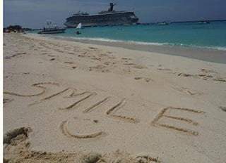 Smile written in the sand