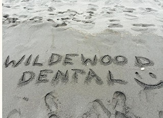 Wildewood Dental written in the sand