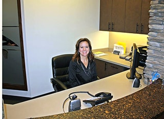The front desk staff at WildeWood Aesthetic Dentistry, a cosmetic dentist in Columbia, SC