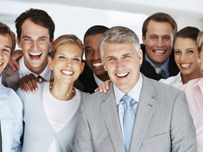 A group of professionals smiling and happy due to porcelain veneers by Dr. Justin Griffin