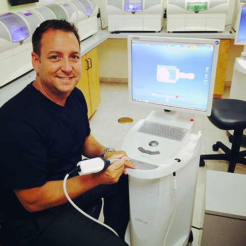 Dr. Griffin with the CEREC same-day crowns machine at his Columbia dental office.